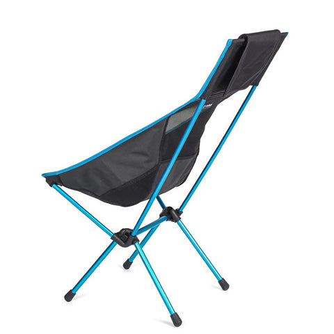 Helinox sunset camp chair side view, carry bag doubles as a neck pillow