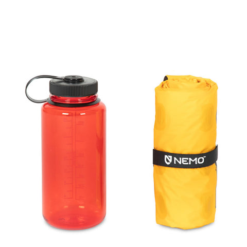 Nemo Tensor Inflatable Sleeping Mat Long Wide packed next to water bottle