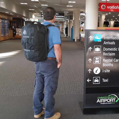 Osprey Farpoint 40 Litre Travel Pack in use at airport on back - Seven Horizons