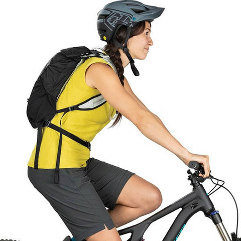 Osprey Women's Kitsuma 7 Litre Women's MTB Hydration Pack in use side view