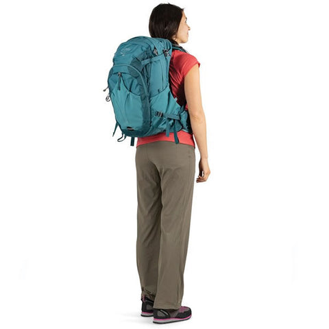 Osprey Mira 32 Litre Women's Hydration Daypack Bahia Blue in use rear view