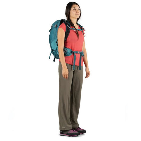 Osprey Mira 32 Litre Women's Hydration Daypack Bahia Blue side view in use