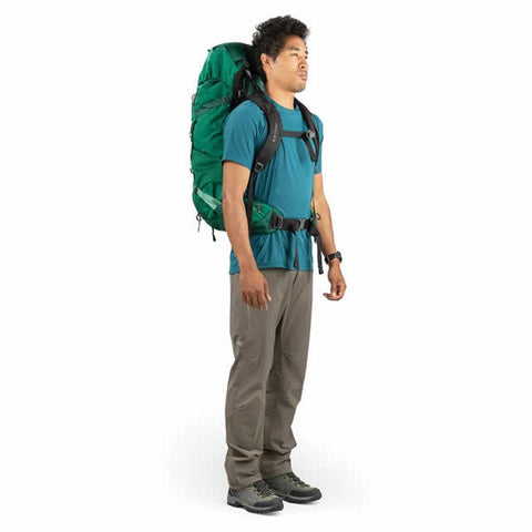 Osprey Rook 60 Litre Men's Hiking Backpack Mallard Green side view in use