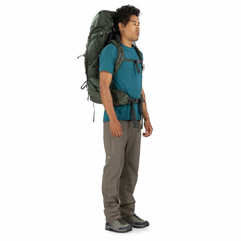 Osprey Volt 60 Litre Hiking Mountaineering Backpack Conifer Green side view in use
