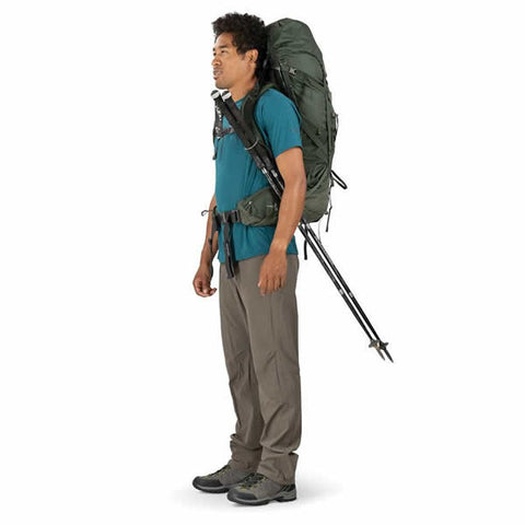Osprey Volt 60 Litre Hiking Mountaineering Backpack Conifer Green in use with trekking poles attached