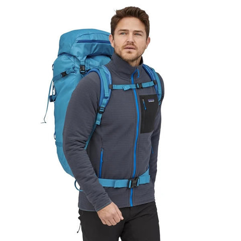 Patagonia Ascensionist climbing mountaineering pack 55 litres in use joya blue front view