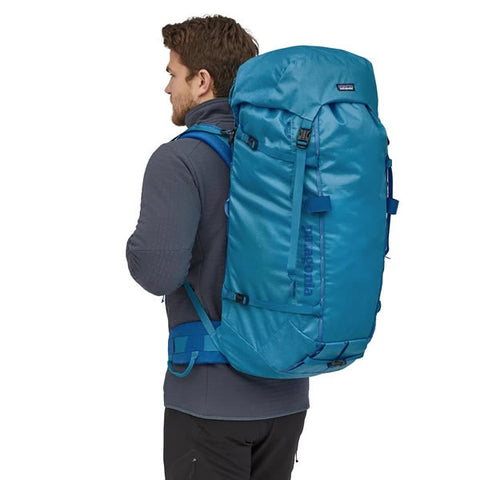 Patagonia Ascensionist climbing mountaineering pack 55 litres in use joya blue