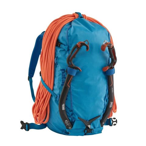 Patagonia Ascensionist climbing mountaineering pack 55 litres in use joya blue attachments for rope and tools