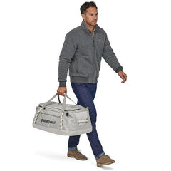 Patagonia Black Hole Duffle 55 Litres in use carry handle