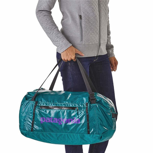 1e8d2abac7 ... Patagonia Lightweight Black Hole Packable Duffle   Duffel Bag 30 Litre  in use carry ...
