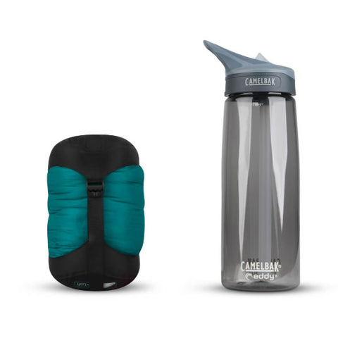 Sea to Summit Traveller Down Sleeping Bag end view packed down next to water bottle