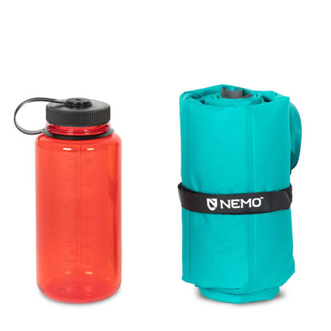 Nemo Astro Insulated Inflatable Sleeping Mat Long Wide packed next to water bottle