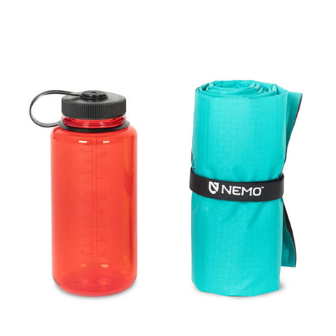 Nemo Astro Inflatable Sleeping Mat Verglas Green packed next to nalgene water bottle