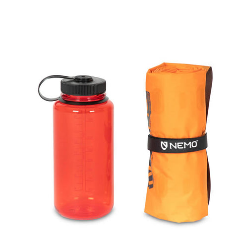 Nemo Tensor Alpine Ultralight Insulated Mountaineering Mat packed next to water bottle
