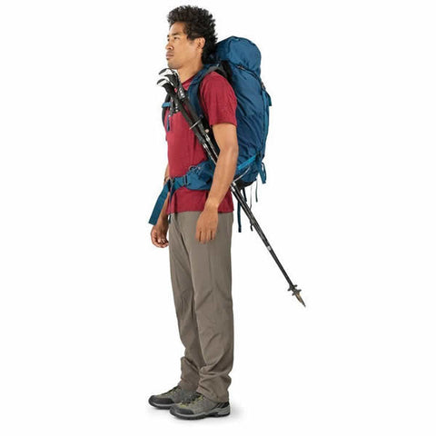 Osprey Kestrel 48 Litre Men's Hiking Backpack in use trekking poles attached