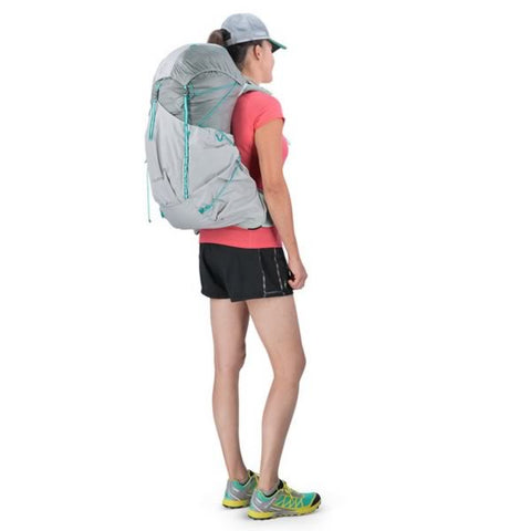 Osprey Lumina 45 Litre Womens Ultralight Hiking Backpack Cyan Silver in use side view