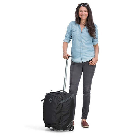 Osprey Ozone 38 Litre 19.5 Inch Global Carry-on Size Wheeled Travel Luggage Black in use