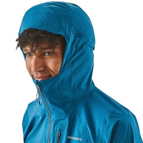 Patagonia Men's Storm Racer Ultralight Waterproof Windproof Breathable Trail Running Jacket in use hood