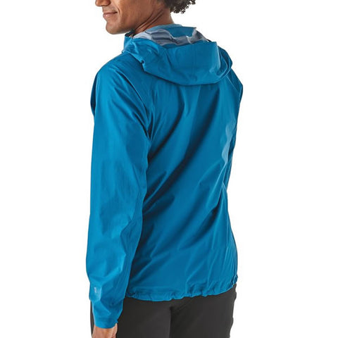 Patagonia Men's Storm Racer Ultralight Waterproof Windproof Breathable Trail Running Jacket in use rear view