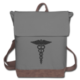 Caduceus Canvas Backpack - gray/brown  in color. Backpack has a flap from from to back with brown straps and trim on the bottom of bag. A caduceus is printed on the front of the bag printed in black.