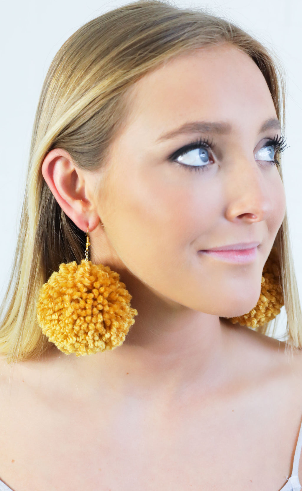pom pom earrings - mustard
