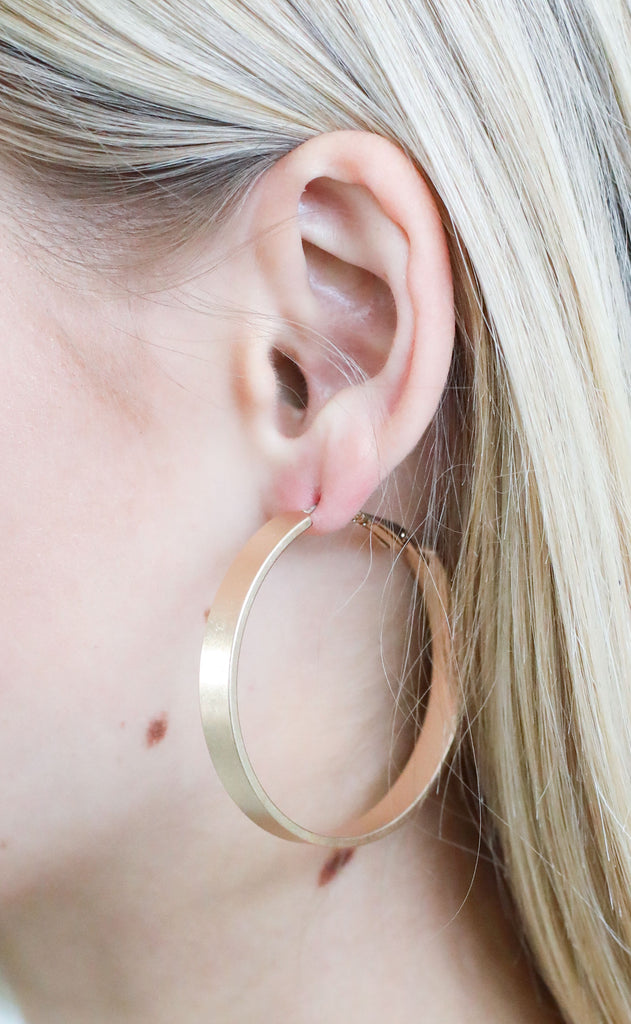 wide metal hoop earrings