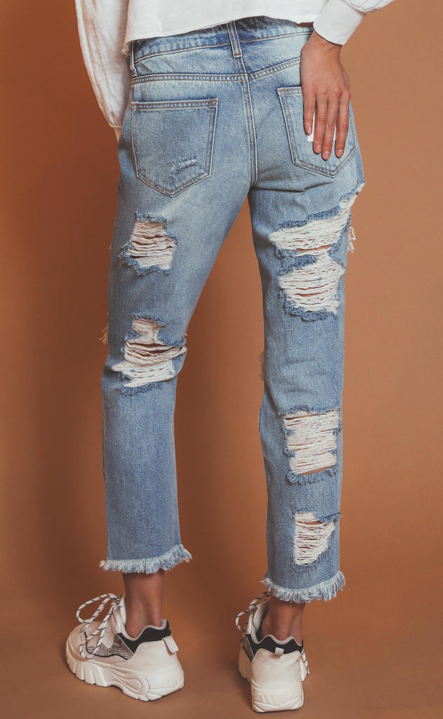 distressed out boyfriend jeans
