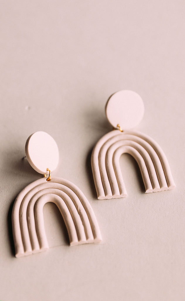 poppy dot: cream arch earrings