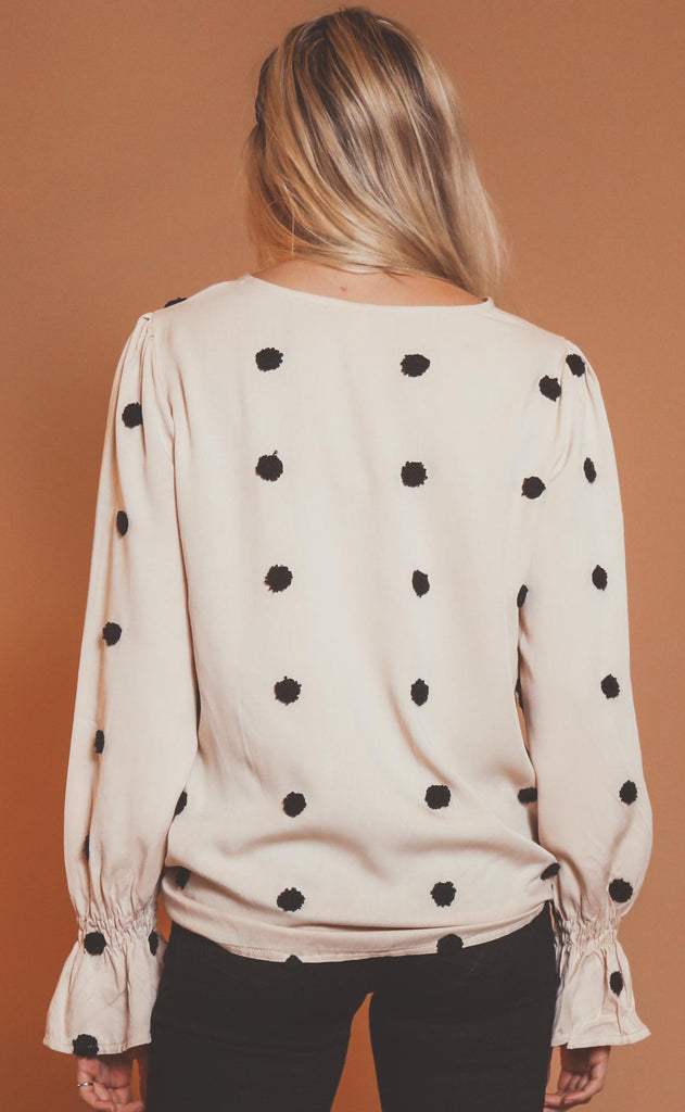 spot on printed blouse
