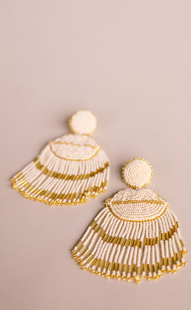 treasure jewels: lip tassel earrings - cream