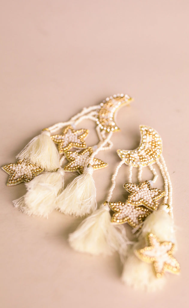 treasure jewels: star moon cream earrings