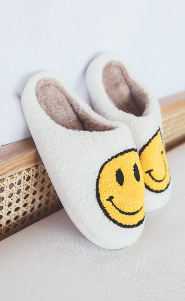 smiley fuzzy slippers - ivory