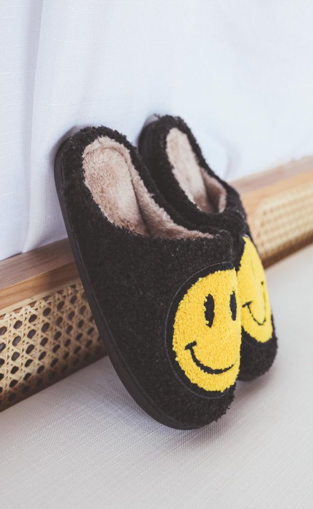 smiley fuzzy slippers - black
