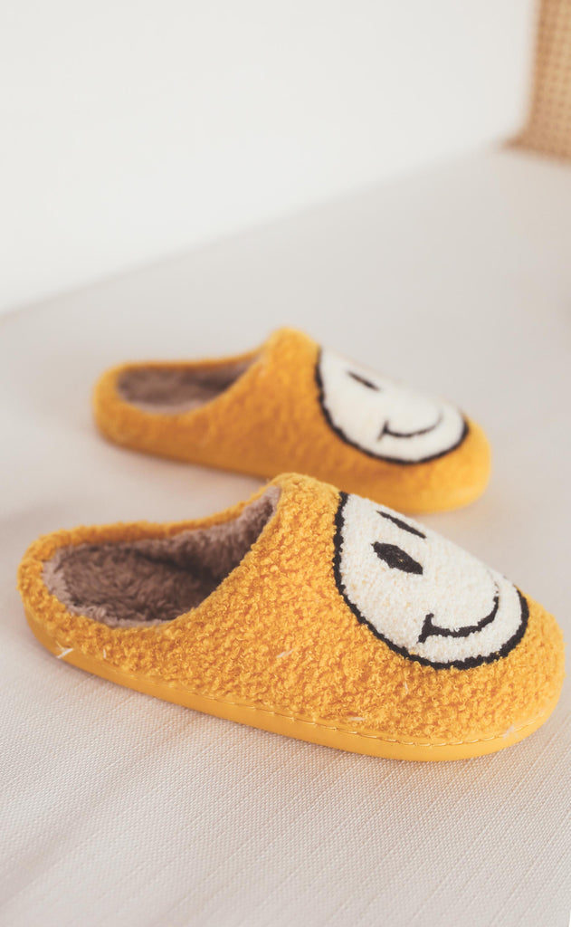 smiley fuzzy slippers