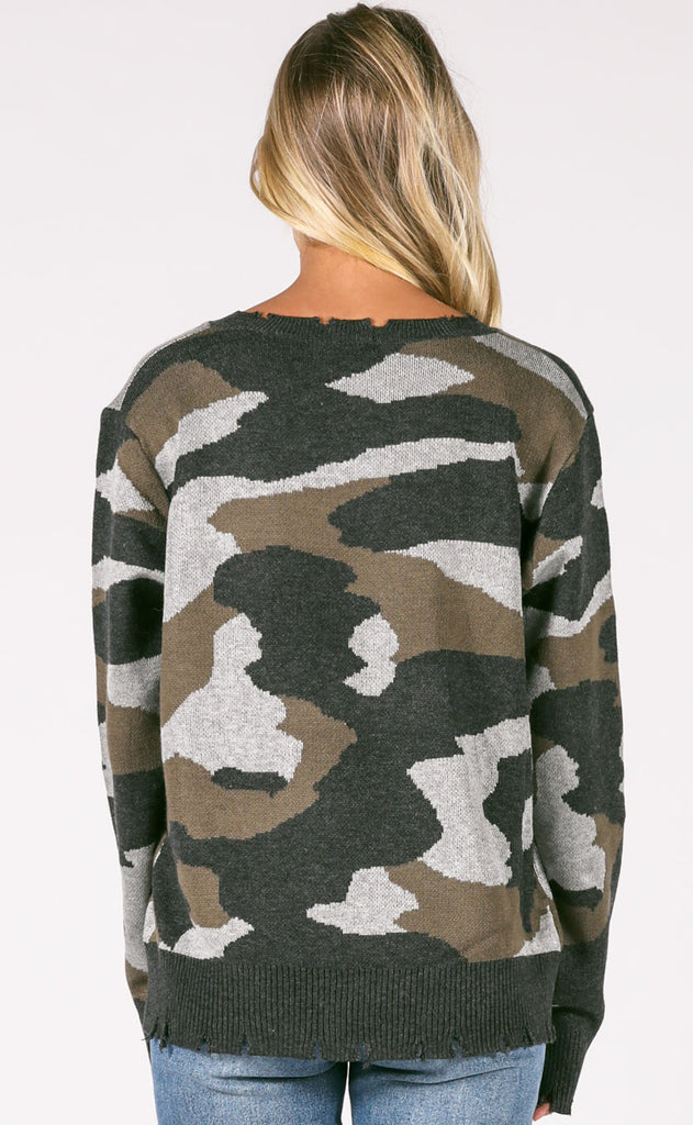blending in camo sweater