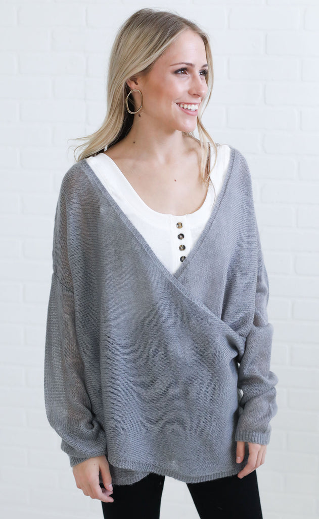 crossed out knit sweater