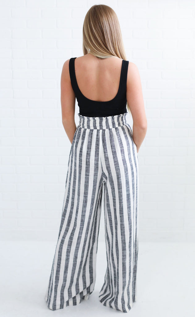 crushing on you striped jumpsuit