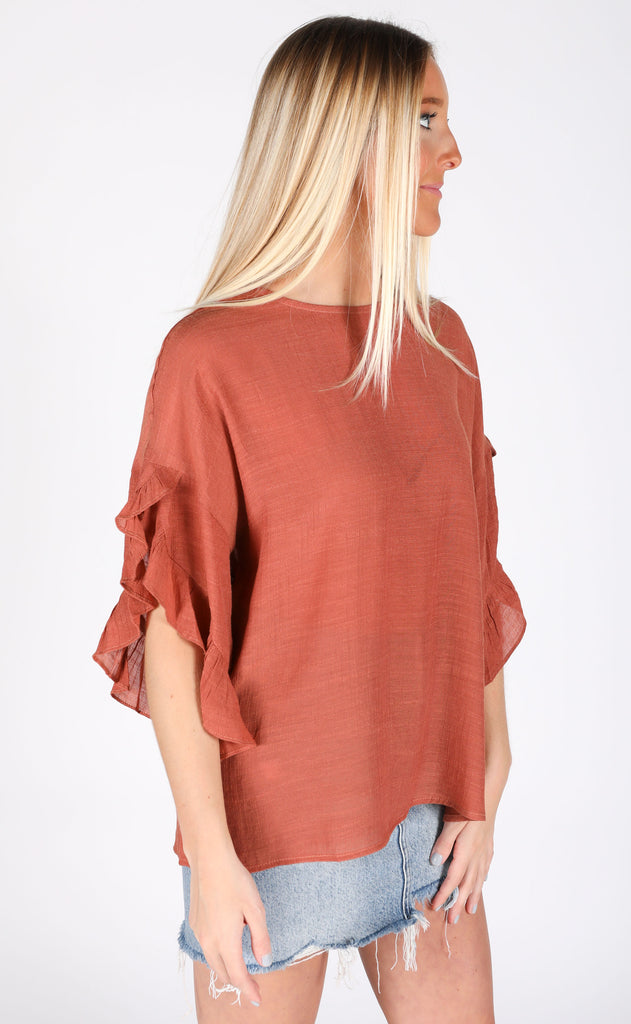 feeling official ruffle blouse - rust