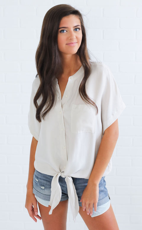 in the moment button up top