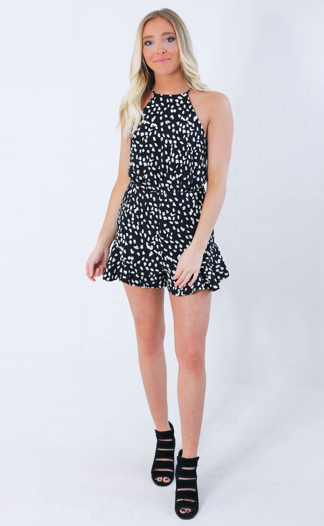 on the spot ruffle romper - black