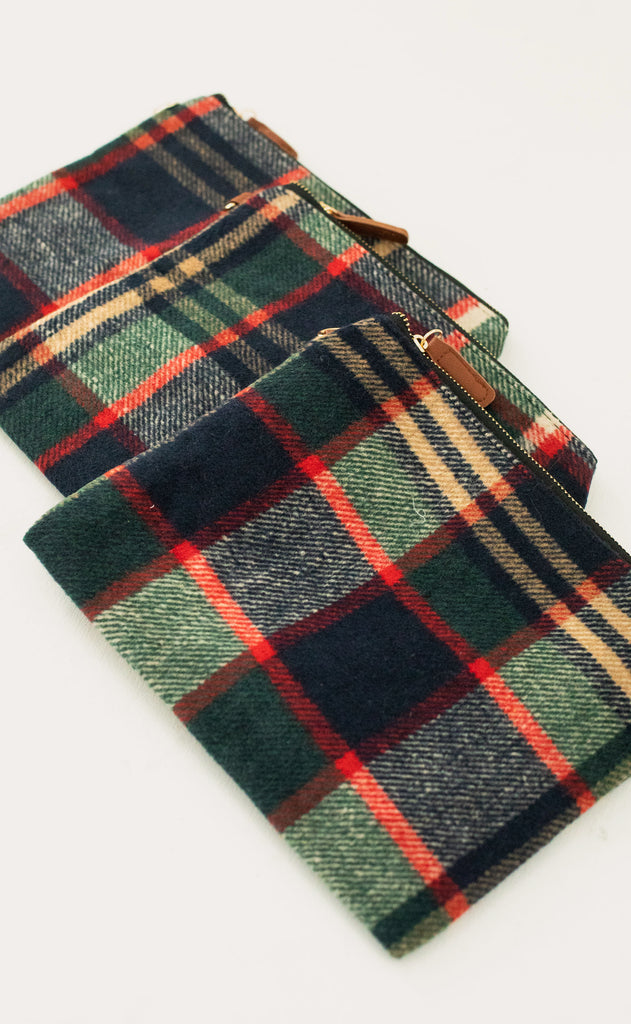 checking out plaid clutch - navy/green