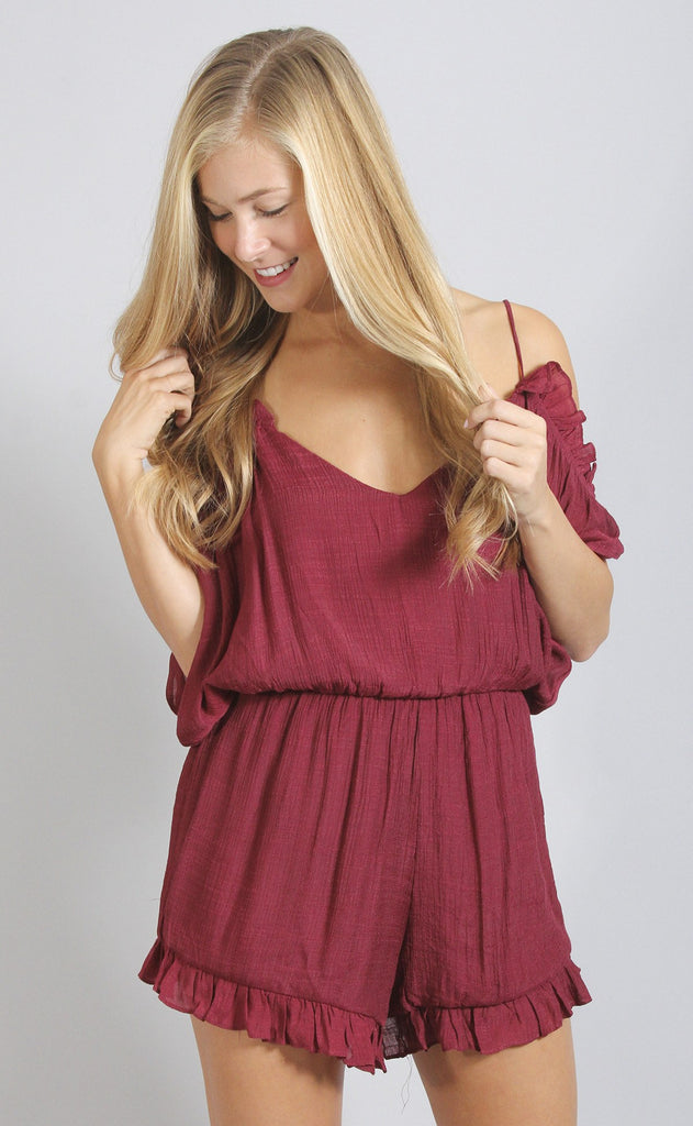 ruffle and bustle open shoulder romper - burgundy