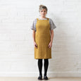 Apron dress linen ochre Workhouse Gallery