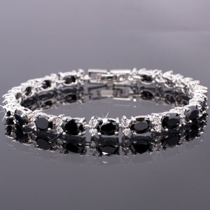 RIZILIA Oval Cut Multi-Color CZ Birthstone 18K White Gold Plated Tennis Bracelet, 7""