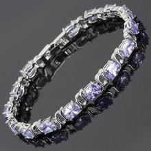 Load image into Gallery viewer, RIZILIA Oval Cut Multi-Color CZ 18K White Gold Plated Tennis Bracelet, 7""