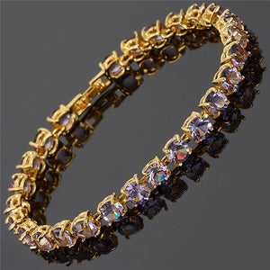 RIZILIA Tennis Bracelet & Round Cut CZ [4 Colors Available] in Yellow Gold Plated, 7""