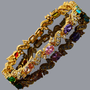 RIZILIA Tennis Bracelet & Oval Cut CZ [Multi-Color] in Yellow Gold Plated, 7""