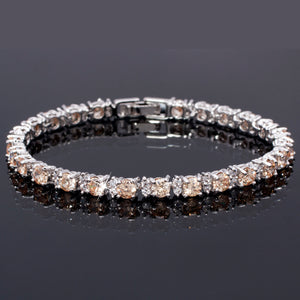 RIZILIA Round Multi-Color CZ Birthstone White Gold Plated Tennis Bracelet, 7""