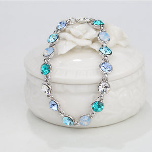 RIZILIA Adjustable Tennis Bracelet & Round Cut Crystal [3 Colors Available] in White Gold Plated