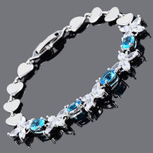 Load image into Gallery viewer, RIZILIA Blossom Tennis Bracelet & Oval Cut CZ [3 Colors Available] in White Gold Plated, 7""